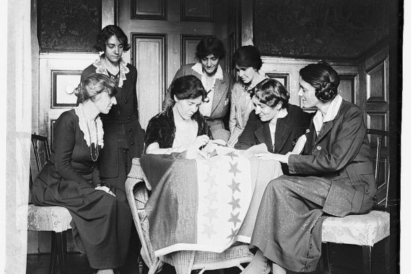 Sewing Stars on Suffrage Flag